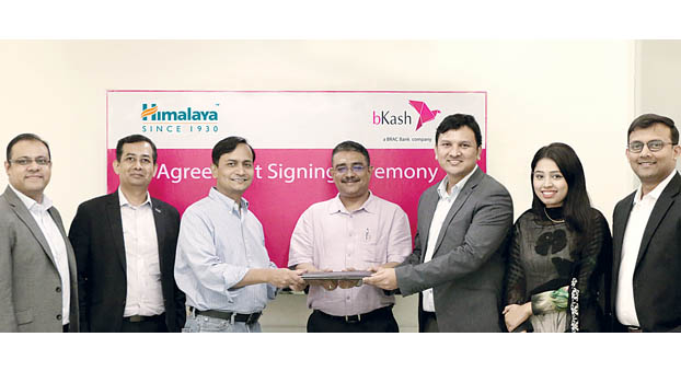 bKash signs deal with Himalaya on disbursement solution to retailers